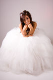 Woman in wedding dress. A young woman wearing a wedding dress Royalty Free Stock Image
