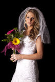 Woman wedding dress on black flowers serious Royalty Free Stock Photography