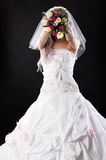 Woman in a wedding dress with a bouquet of tulips Stock Photography