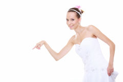 Woman in wedding dress choosing picking up isolated Royalty Free Stock Photo