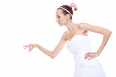Woman in wedding dress choosing picking up isolated Stock Image