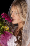 Woman wedding dress flowers side smell Stock Photography