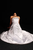 Woman in wedding dress on her knees stock photos