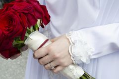 Woman holding bouquet of roses stock photography