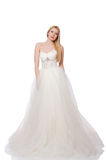The woman in wedding dress isolated on white Stock Images