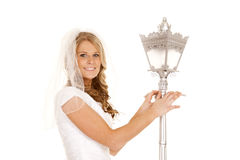 Woman wedding dress lamp post hold Royalty Free Stock Photography