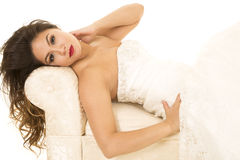 Woman in wedding dress laying arm on neck looking Stock Photography