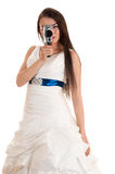 Woman in a wedding dress with the old Soviet video camera. Isolated on white background Stock Images
