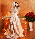 Woman in  wedding dress relaxing in bath. Stock Photography