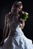 Woman in wedding dress smelling Royalty Free Stock Image