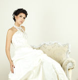 Woman in wedding gown Stock Image