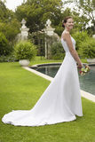 Woman In Wedding Gown At Poolside Royalty Free Stock Image