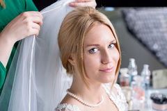 Woman during wedding preparations Stock Images