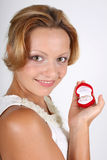 Woman with wedding rings in red box Stock Photo
