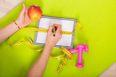 Woman with a weekly planner Royalty Free Stock Photo