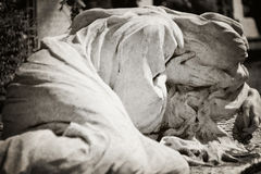 Woman weeping tombstone - textured Stock Photo