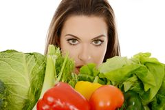 Woman with wegetables. Beautiful woman holding vegetables isolated on white. Bascet full of pepper, lettuce, savoy and tomato royalty free stock image