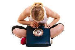 Woman with weighing scale dieting slimming. Royalty Free Stock Photo