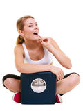 Woman with weighing scale dieting slimming. Royalty Free Stock Photography
