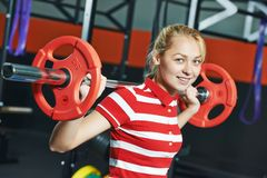 Woman with weight bar in fitness gym Royalty Free Stock Photos
