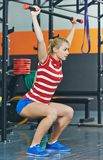 Woman with weight bar in fitness gym Royalty Free Stock Image