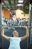 Woman weight lifting in gym Stock Photo