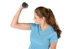 Woman with weight looking at arm Stock Photo
