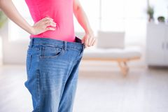 Woman weight loss concept royalty free stock images