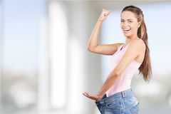 Weight Loss Woman, isolated on  background. Woman weight loss large blue isolated shape Royalty Free Stock Photography