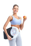 Woman with a weight scale. Healthy young woman with a weight scale. Isolated over white background royalty free stock images