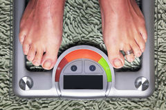 Woman on the weight scale Royalty Free Stock Images