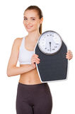 Woman with weight scale. Stock Photos