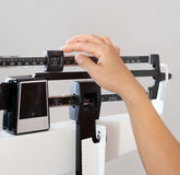 Woman on Weight Scale Closeup Royalty Free Stock Photo