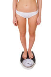 Woman with weight scale. Royalty Free Stock Photo