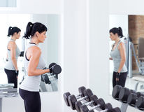 Woman with weight training equipment on sport gym. Woman with weight training equipmant on sport gym club Stock Photos