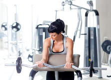 Woman with weight training equipment on sport gym stock photo