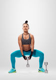 Woman weight workout. squats Stock Images