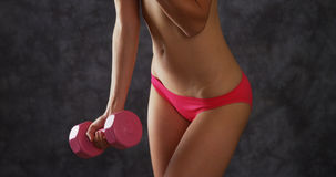 Woman weightlifting in pink underwear Stock Photos