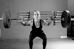 Woman on a weightlifting session - crossfit workout Stock Image