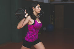 Woman with weights at the gym Stock Images