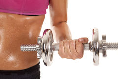 Woman weights sweaty stomach Royalty Free Stock Photography