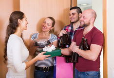 Woman welcomes smilingl friends Stock Images