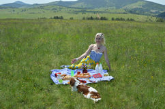 Woman Welcoming to Picnic. Woman with dog making gesture with her hands - welcome to picnic Royalty Free Stock Photography