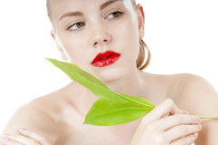 Woman with a well-groomed complexion. Beautiful woman with a healthy and well-groomed complexion holding green leaf . Spy beauty skin treatment woman. Healthy stock photos
