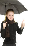 The woman is well under an umbrella Royalty Free Stock Photos