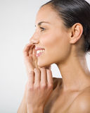 Woman and wellbeing. A profile view of a beautiful young woman smiling Stock Photos