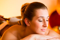 Woman at Wellness massage with singing bowls Royalty Free Stock Photos