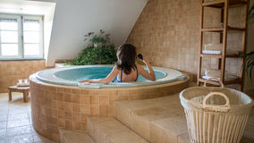 Woman in wellness room. Woman in jacuzzi whirpool in private spa wellness room Stock Photo