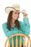 Woman western green shirt chair looking Royalty Free Stock Photo