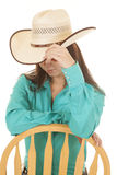 Woman western green shit chair look down Stock Image